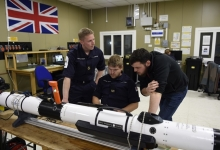 Members of the Royal Navy seen with the Iver unmanned underwater vehicle