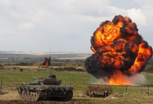A Hollywood film company was hired to rig pyrotechnic explosions for a mock battle demonstration on Salisbury Plain  Read more: http://www.dailymail.co.uk/news/article-3860116/Are-watching-Putin-British-Army-calls-Hollywood-make-explosions-extra-realistic-strength-against-imaginary-Russian-force.html#ixzz4O6VpNAhP  Follow us: @MailOnline on Twitter | DailyMail on Facebook