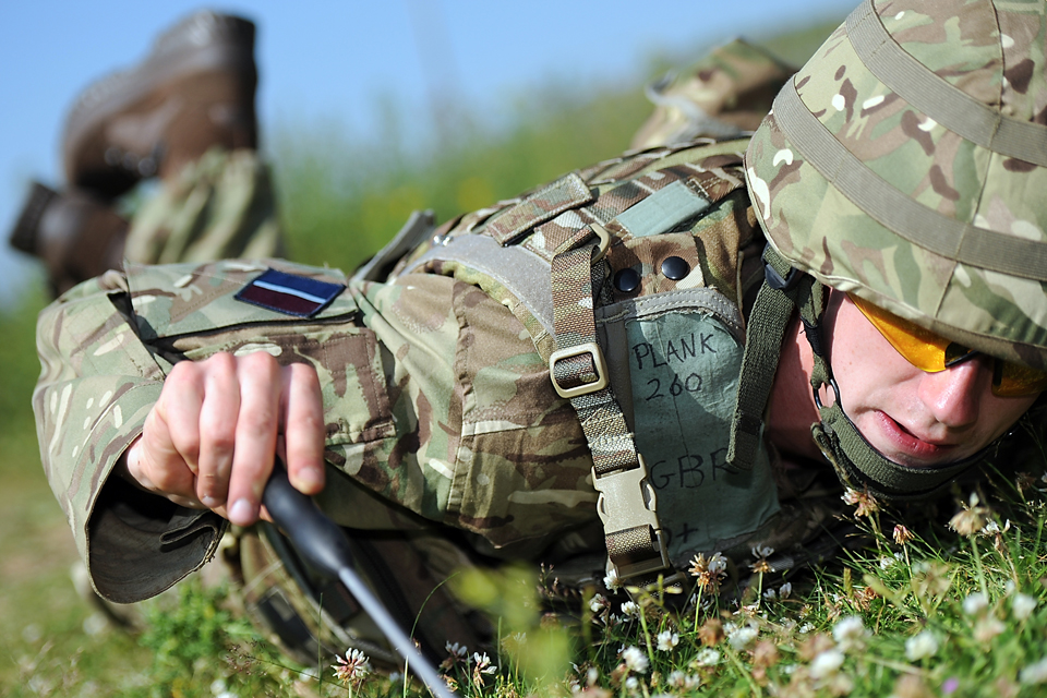 A RAF Regiment trainee practises checking for mines using the 'pat, poke and prod' technique