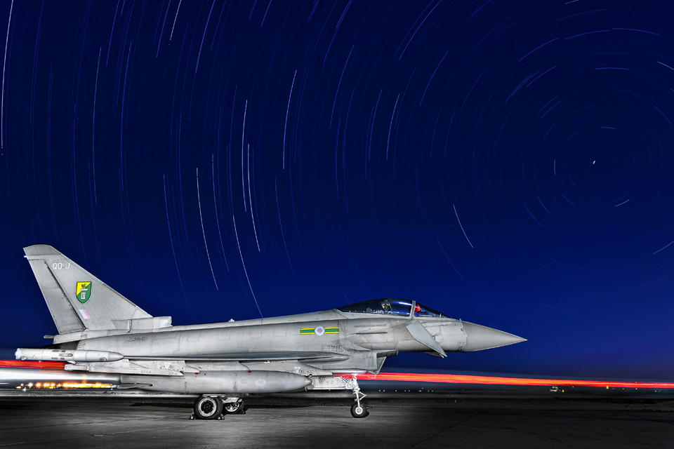 A 3 (Fighter) Squadron Typhoon sits under a star-lit sky in the Middle-East